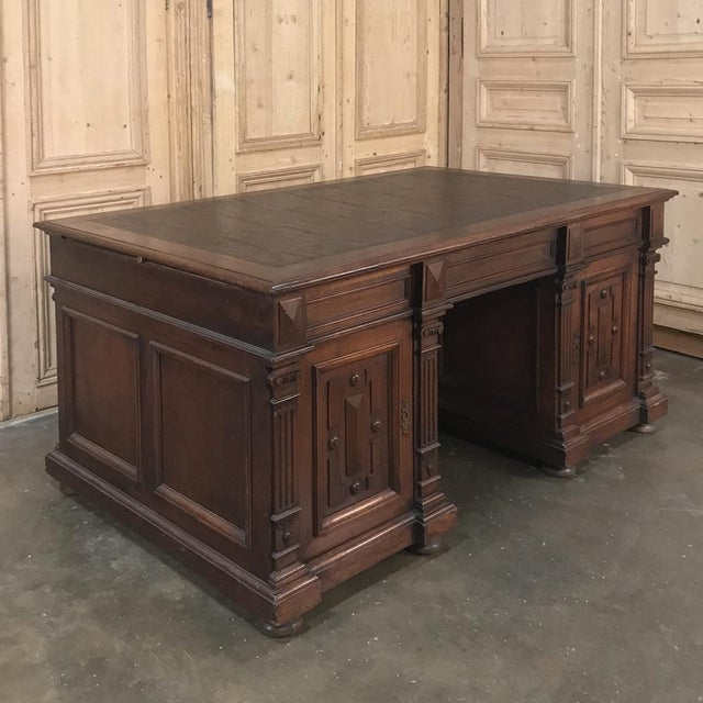 19th Century French Henri II Walnut Partner's Desk represents the restrained elegance that is the hallmark of the style....
