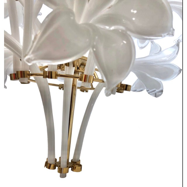 Stunning brass chandelier with removable murano glass lily stems. This spectacular piece will make any space come to life...