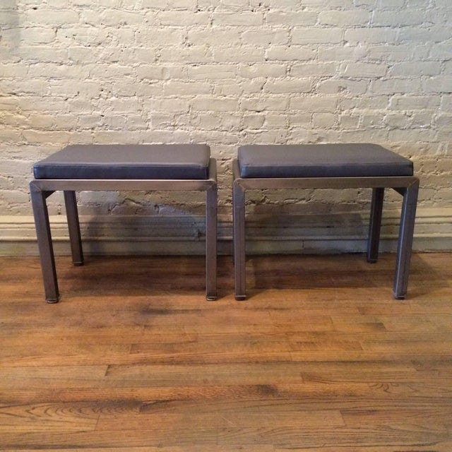 Pair of Art Deco ottomans or stools by Norman Bel Geddes for Simmons furniture company are brushed steel with newly...