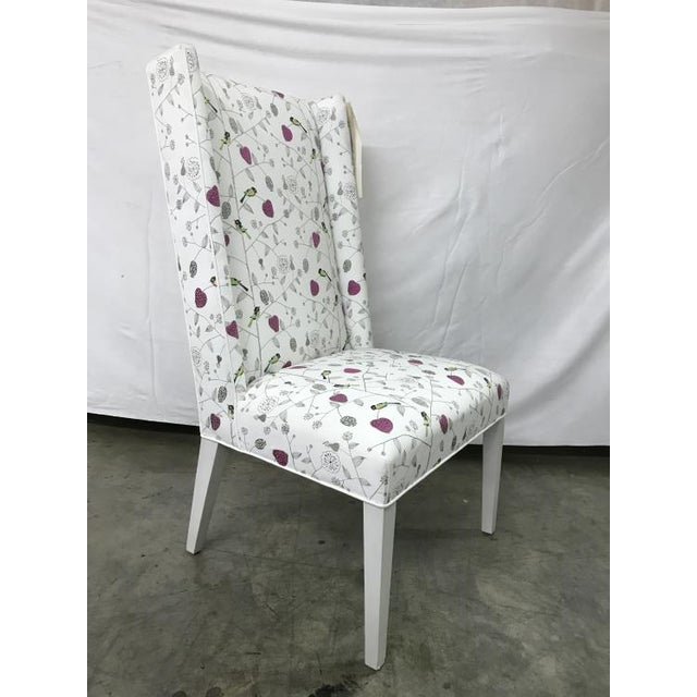 The Penelope Dining Chair is a first quality market sample that features a Patterned Fabric with an Oyster Finish.