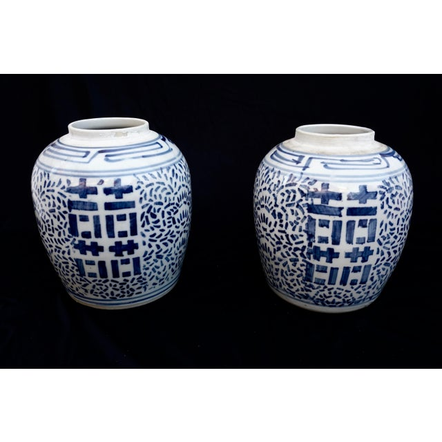 Stunning large scale pair of matching Chinese blue and white porcelain ginger jars/vases/urns. Featuring a shapely,...
