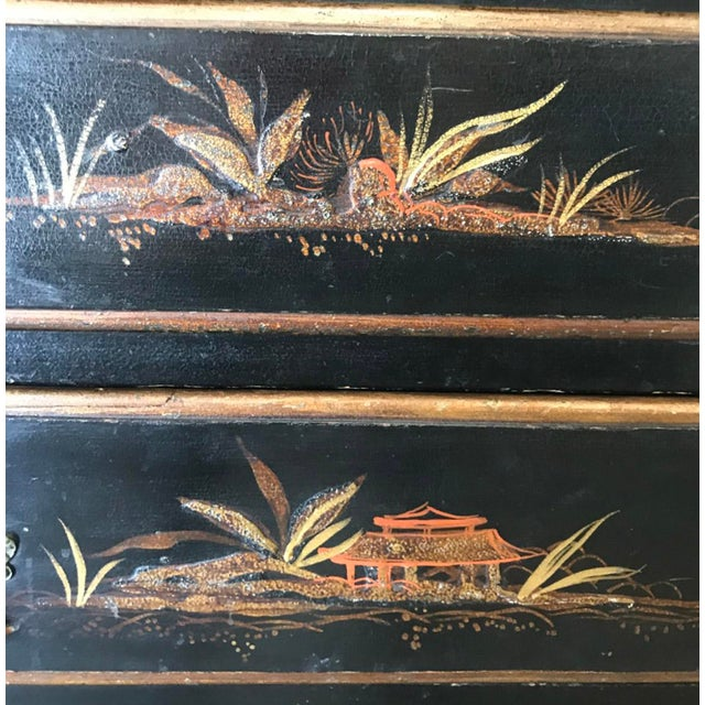 Unusual chinoiserie chest of drawers as it is only 13 inches deep. Five graduated drawers with raised decorated motives;...