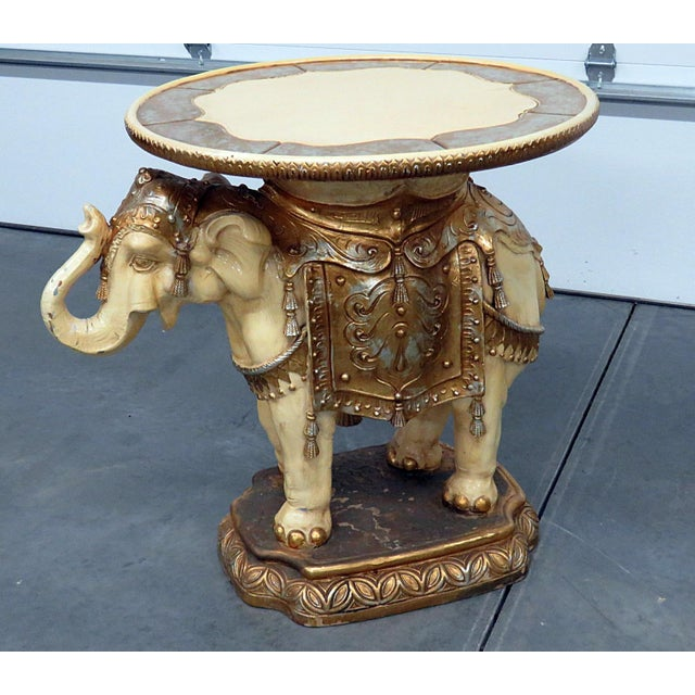 Indian elephant distressed painted center table with gilt decor.