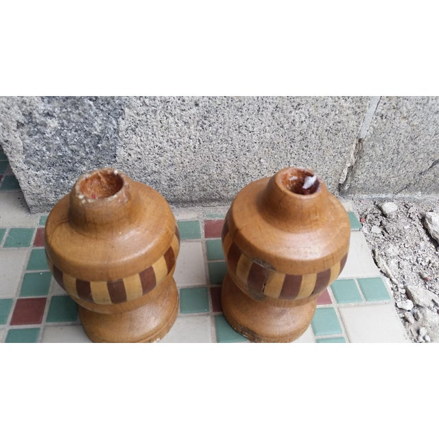 Here's a pair of candle holders that belong in a rustic setting. These are lathe turned with alternating veneer panels of...