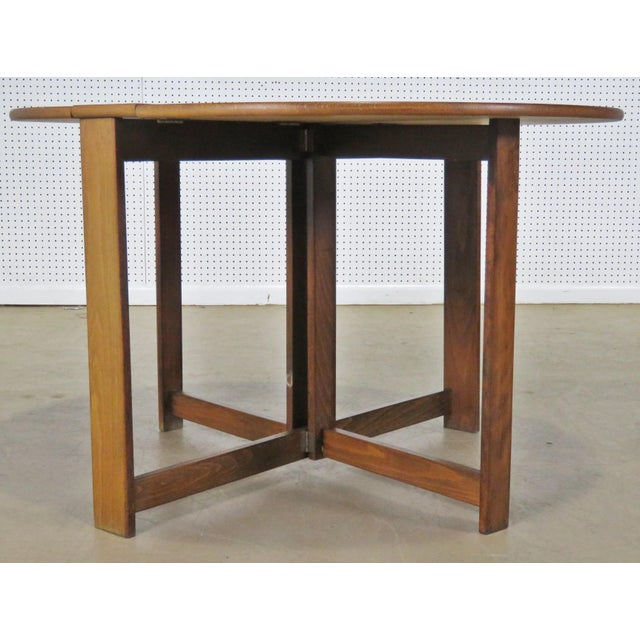 """Mid-Century Modern Teak drop leaf table. The table is 8"""" wide with leaves down."""