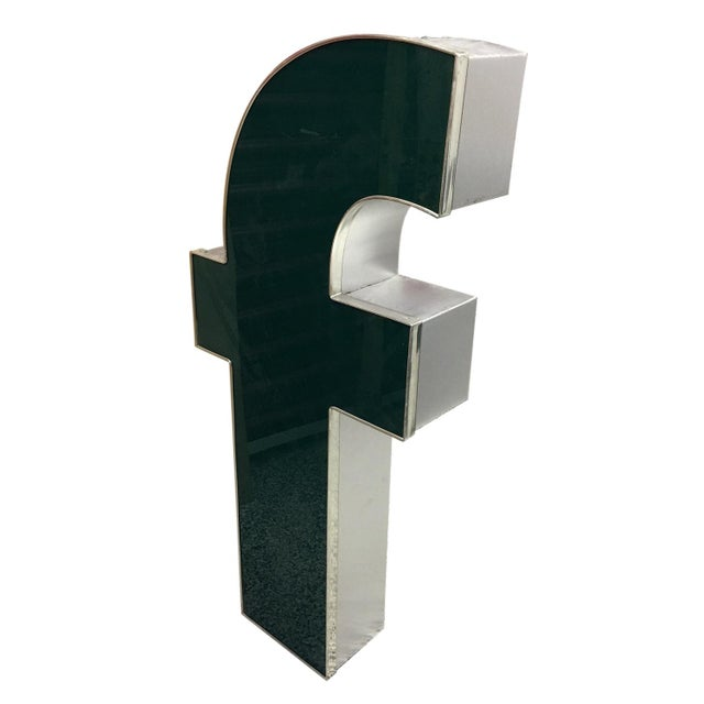 """A lower case """"f"""" channel letter made of aluminum and plexiglass. A lovely decorative piece to display."""
