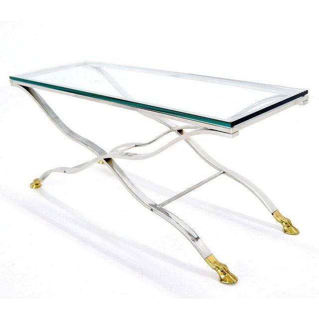 High quality highly polished solid chrome glass top console table.