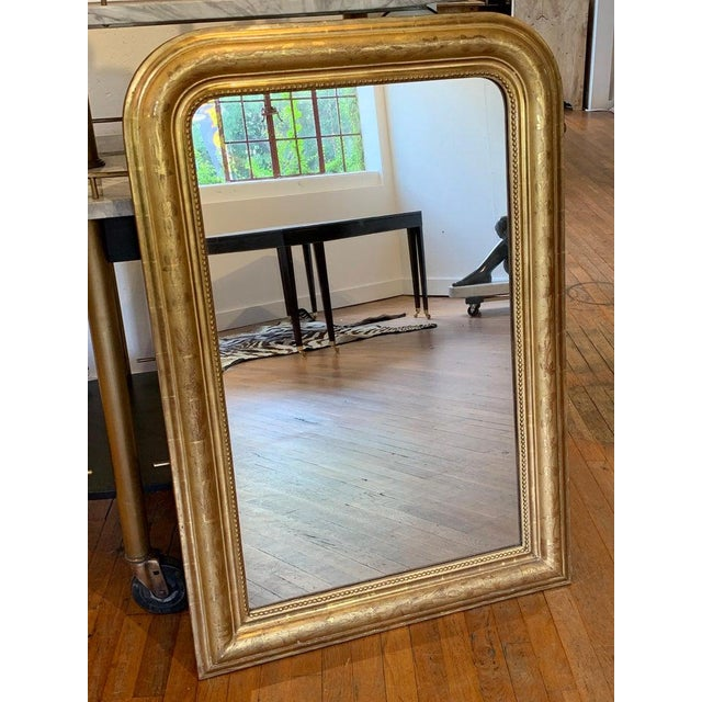 """Fine 19th century Louis Philippe giltwood incised decorated mirror, with rounded top, 41"""" x 21"""" inset mirror."""