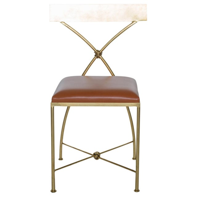 The Ivey Dining Chair has elegantly sloping legs and a slightly curved back. The stool is constructed of solid steel and...