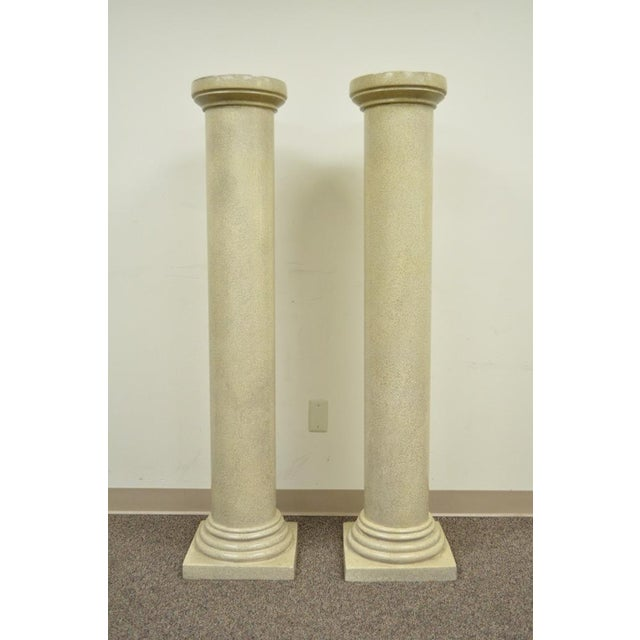 "Item: Pair of 60"" Tall Cast Fiberglass Column Form Pedestals Details: Faux concrete finish, Stately Classical form,..."