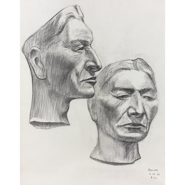 This is an Academy style charcoal on paper portrait study of a frontal figure and profile; signed and dated 1949; In a...