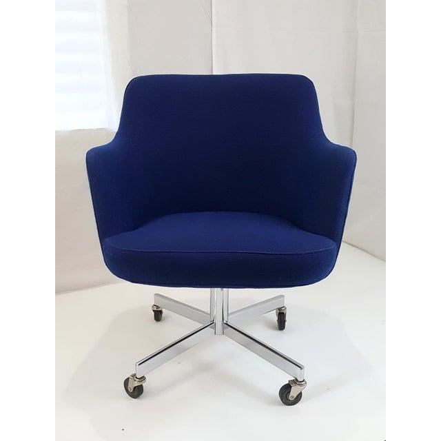 An Office Or Desk Chair On Castors Featuring Sculptural Fluid Lines Saturated Dark Blue Original