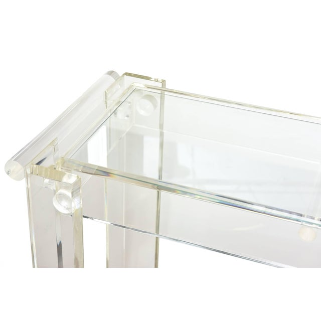 This vintage Lucite bar or trolley cart has two tiers. The bottom is mirrored glass and the top is clear glass. The...