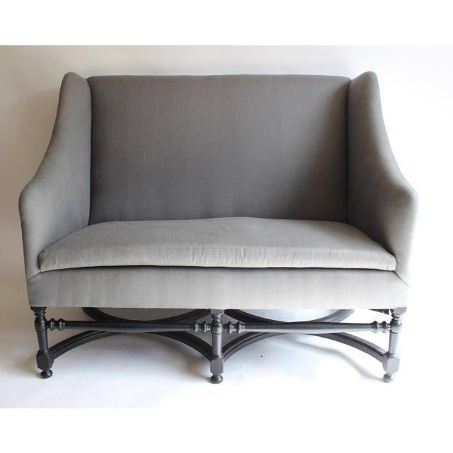19th century French ebonized wood settee. Newly upholstered.