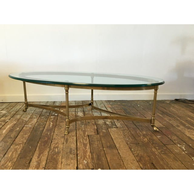 A stunning brass coffee table by LaBarge. The lines on this table are elegant and timeless. LaBarge made fine quality...