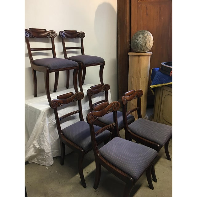 Set of six antique English chairs in crotch mahogany, hand carved with swag and acanthus leaves at the back rail. the...