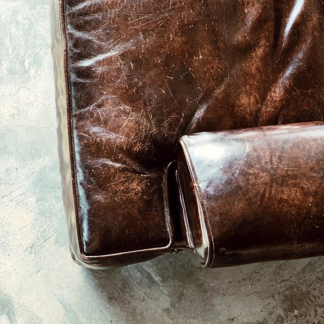 1960's vintage Monarch company patent leather sofa. In the style of club seating. This is the perfect mix of traditional...