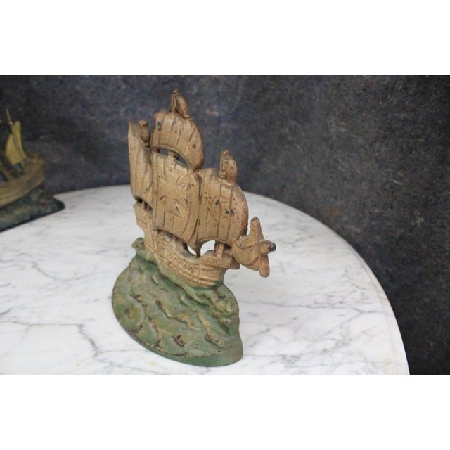 Cast iron door stop formed to mimic one of the three ships of Christopher Columbus.