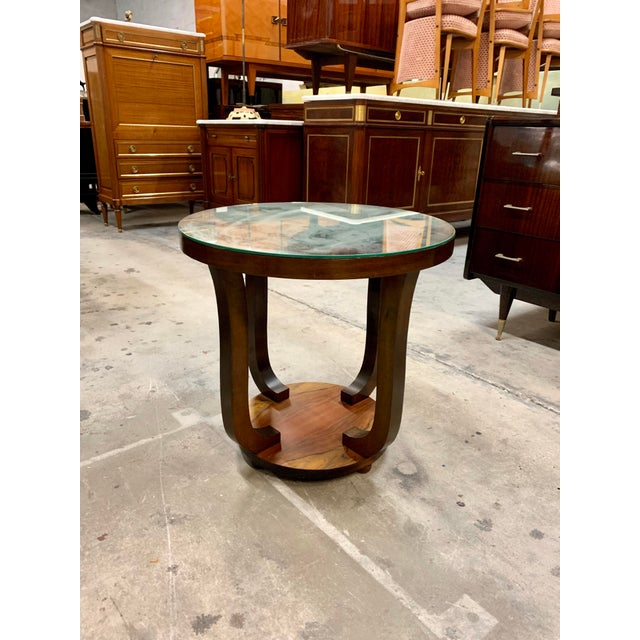 French Art Deco ''tulip'' Macassar coffee table or side table mirror top 1940s. One-top shelves with mirror supported by...