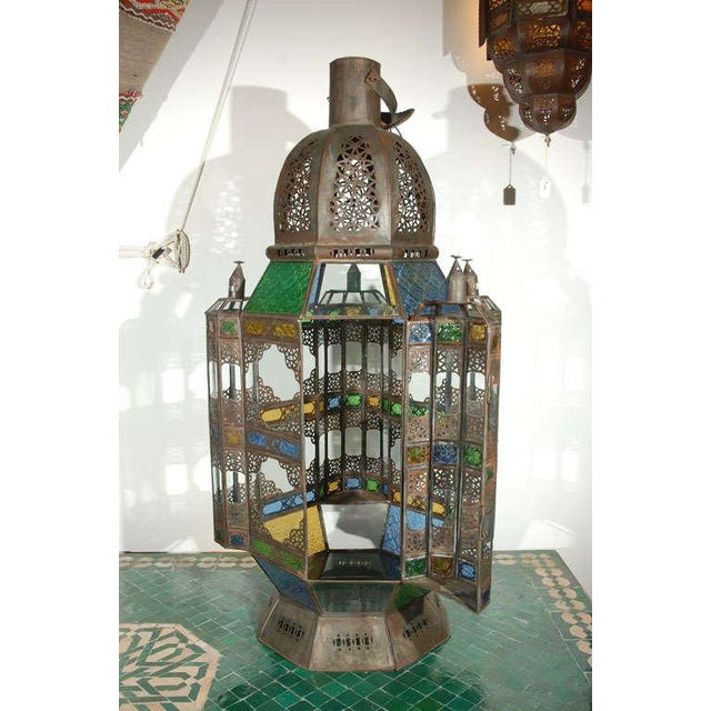 Extra large Moroccan glass candle lantern from Marrakesh. High end traditional Moroccan lantern handcrafted in Morocco by...