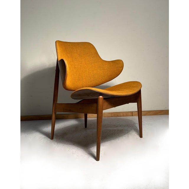The most desirable form of the kodawood chairs. Clamshell back. Danish modern, Kofod Larsen Adrian Pearsall style. Most...