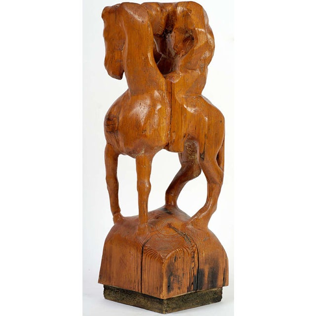 """Sculpted from a single piece of 34"""" tall wood, this work portrays a man on his horse, wearily resting his head on the..."""