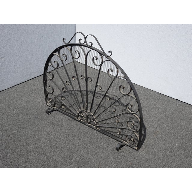 Vintage Spanish Style Black Metal Fireplace Screen w Scrolls Gorgeous Chair in Great Vintage Condition. Solid and Firm....