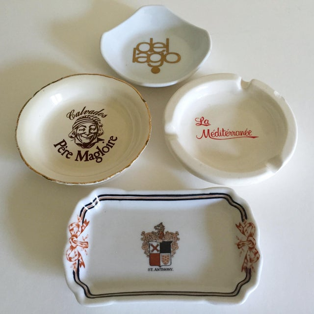 This set of four vintage Mid Century international hotel and restaurant ceramic ashtrays are a very special and unique set...