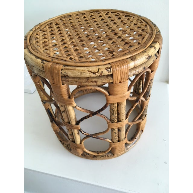 "This vintage ""tabouret"" or drum style bamboo and wicker side table has the burned ""tortoise"" effect which is done by hand..."