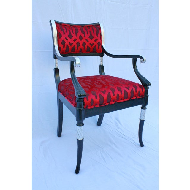 An Italian Silver Leaf Accent Chair in a beautiful black wood finish with a bright design red fabric.