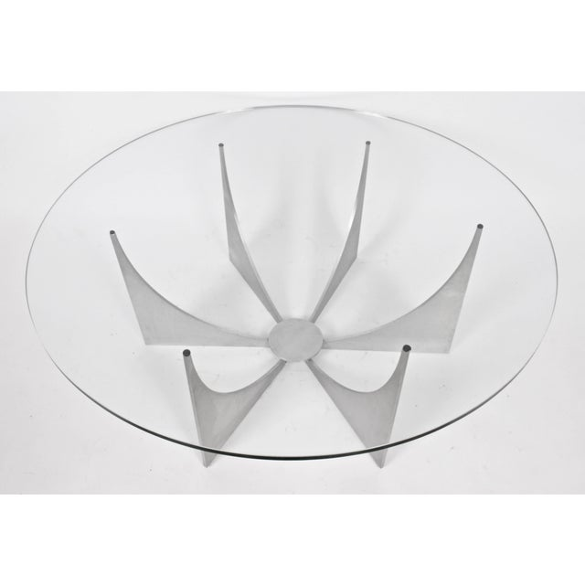 Donald Drumm modernist round cast aluminum and glass cocktail table coffee table, circa 1970. Classic. Large. Sculptural....