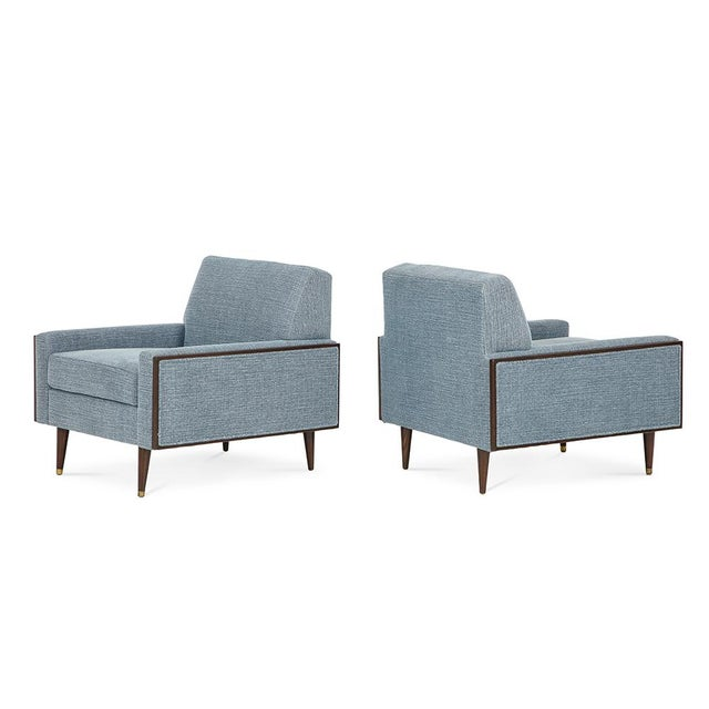 A pair of Mid-Century Modern club chairs, with walnut frame, 1950's. New upholstery. Place of Origin: Europe
