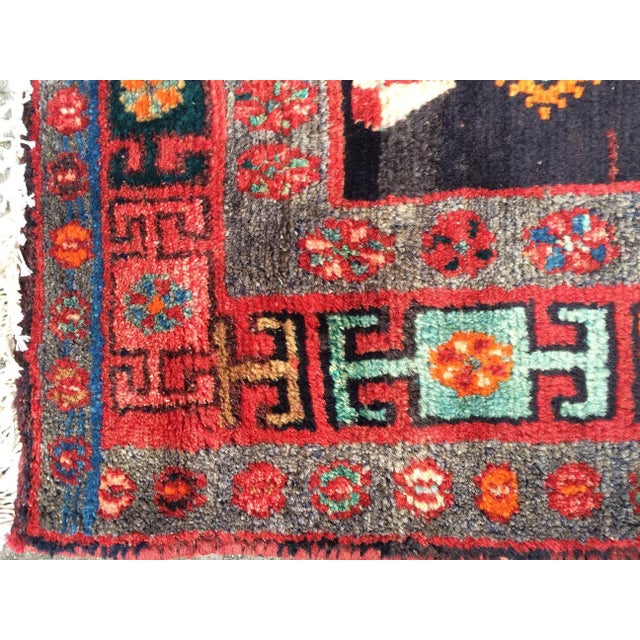 This hand woven Persian rug with its decorative lines and vibrant colors goes beautifully in any space.
