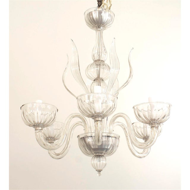 Italian Venetian Murano 1940s style (modern) clear glass chandelier with eight fluted scroll arms supporting large bowls...