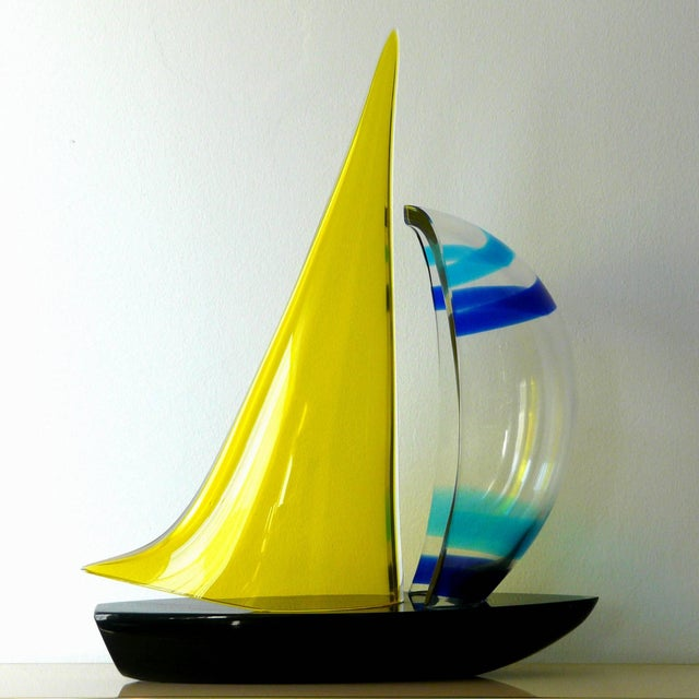 Beautiful black, yellow, clear, navy blue and baby blue Murano glass sailboat by Romano Dona. Murano sailboat by Romano...