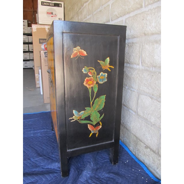 Colorful hand painted with flowers and butterflies. This cabinet is a beautiful art piece and functional.