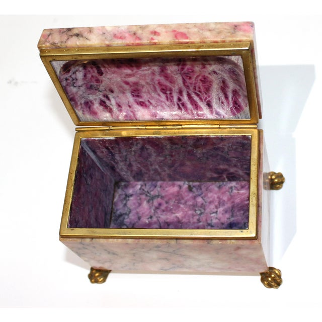 Antique Jewelry Casket with Gold Dore Accent - Ouside shades of pink, inside the stone-like material is scooped out on...