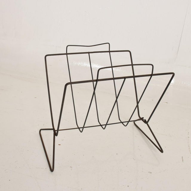 For your consideration, a Mid Century Modern Sculptural Iron Magazine Rack. Beautiful clean modern lines. The USA circa...