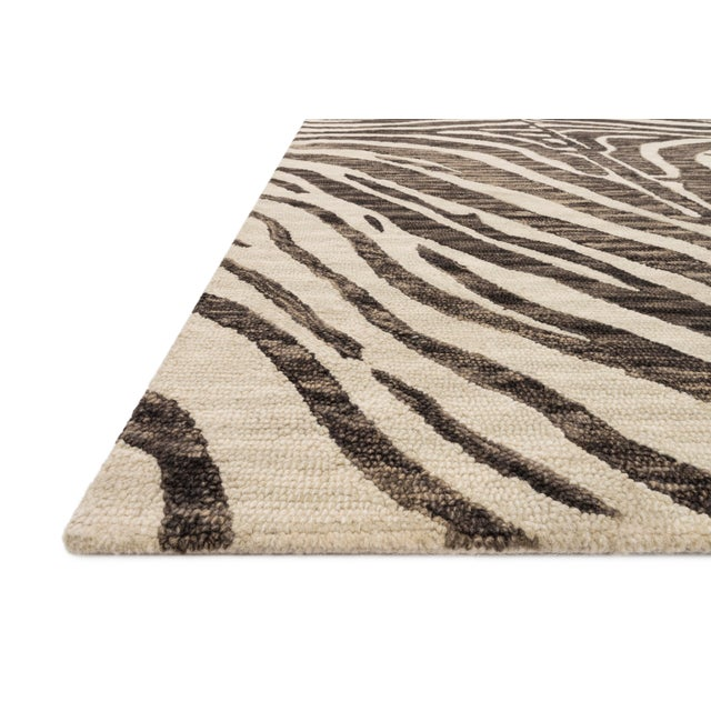 Hooked of 100% wool, this Masai Collection is a softer side of the savannah brought to life by artisans in India. Masai is...