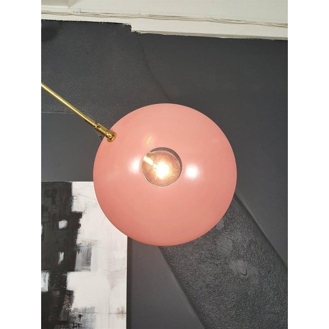 """Striking """"Counterpoint"""" pendant light in unlacquered brass and bubblegum pink enamel fabricated in NYC by Blueprint..."""