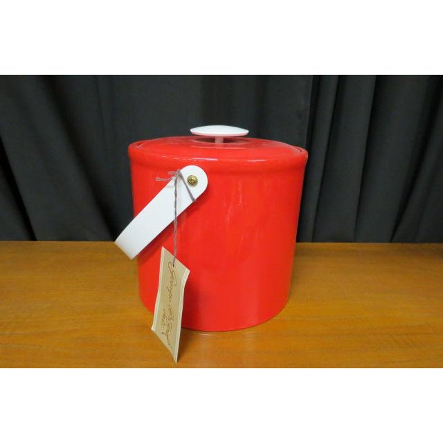 Bright red plastic ice bucket with red vinyl lid, white handle, and white interior. Perfect for your outdoor table. Comes...