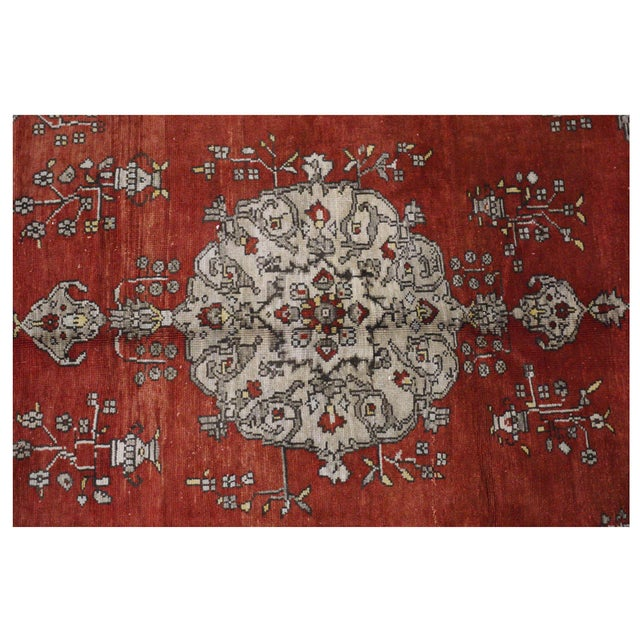 This beautiful rug is hand made, %100 wool pile, made in Turkey, Ushak region. It features a pattern in a vibrant...