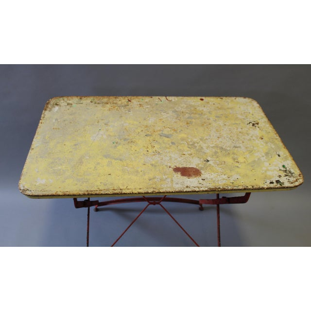 Folding Painted Metal Bistro Table With Red Legs For Sale - Image 4 of 7