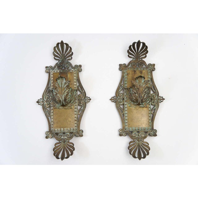Beaux-Arts period solid bronze wall sconces of exceptional design having pronounced anthemions either end of gently bowed...