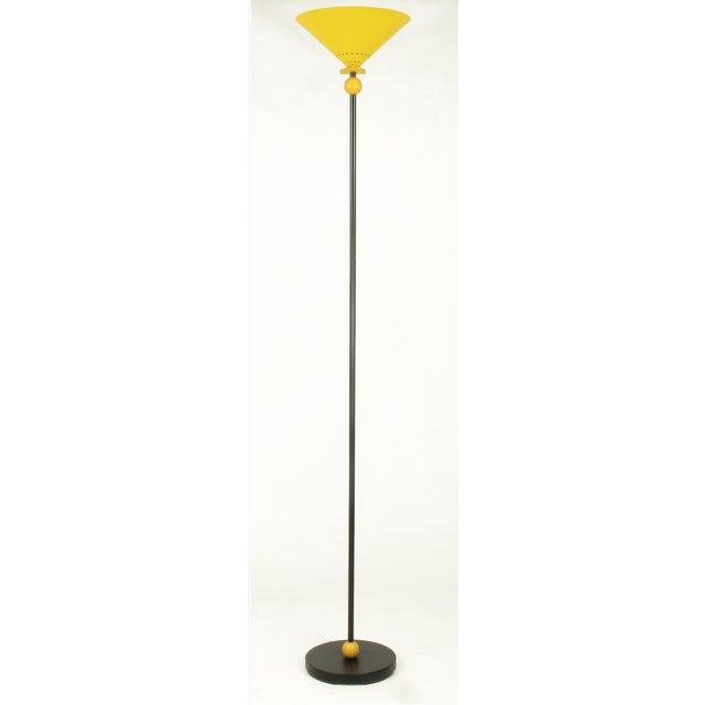 Memphis Group inspired floor lamp consisting of lacquered and pierced yellow conical shade and yellow lacquered wood ball...