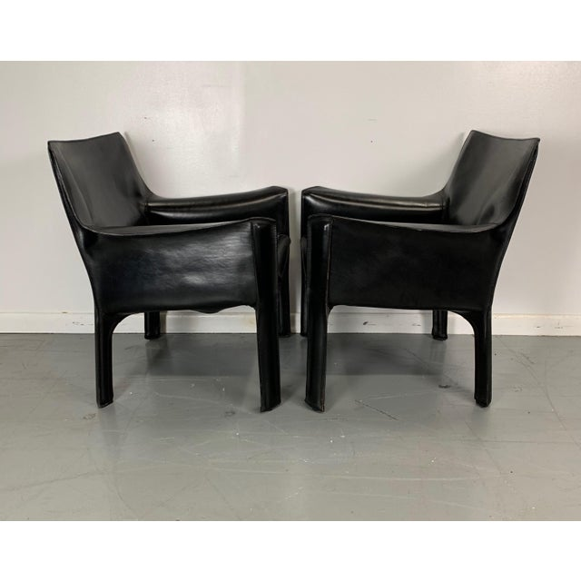 Black cab armchairs by Mario Bellini for Cassina. Leather is in excellent condition. Two available. Priced as a pair.