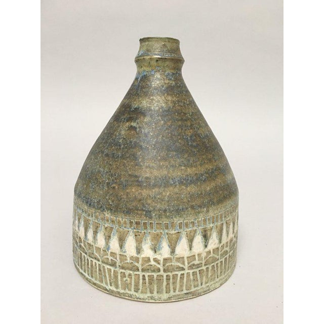 This hive shaped stoneware vase is from Norwegian studio potter Hald Soon, ca. 1960s. It features a blue/green/brown...