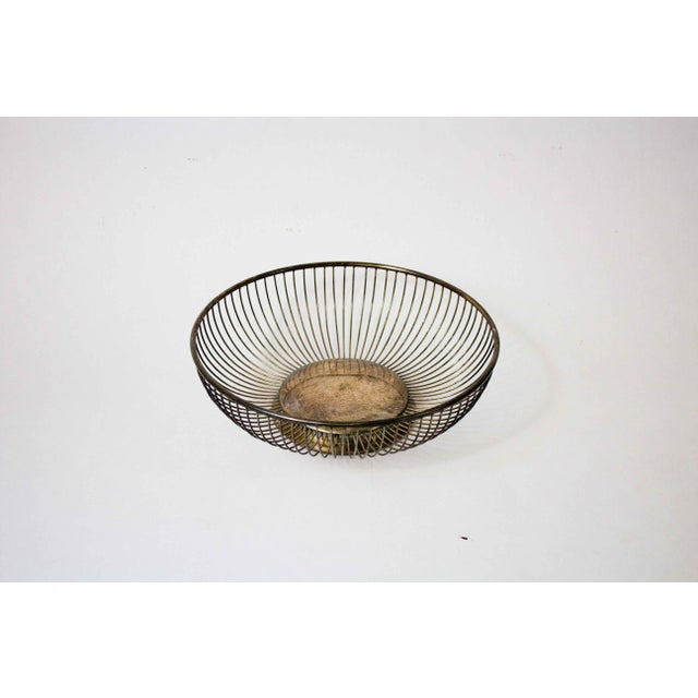 Vintage silverplate wire fruit basket. Beautifully aged to bring warmth to your kitchen, bar, or breakfast nook.