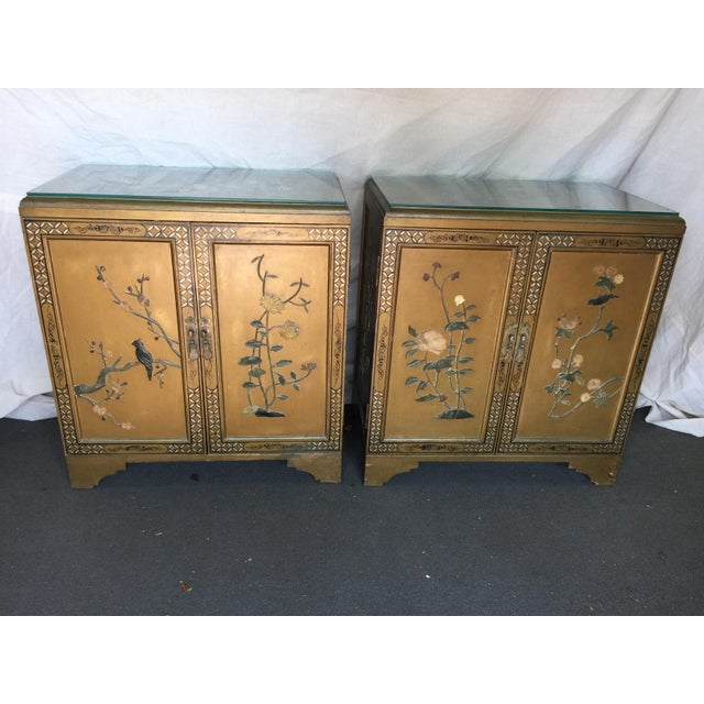 Pair of Chinoiserie tables with hardstone decoration . Gold with glass tops. In good condition with only one chip on the...