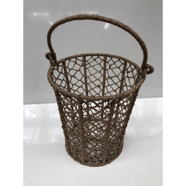 The natural color jute woven onto a metal bucket with an intricate pattern! Now in an updated version, these buckets are...